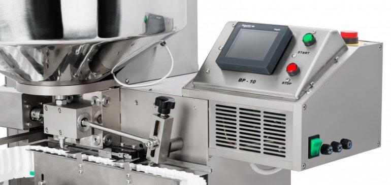 proceso de llenado en contenedores termoformados